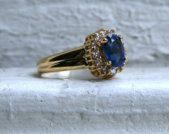 Vintage 18K Yellow Gold Diamond Halo and Sapphire Engagement Ring.