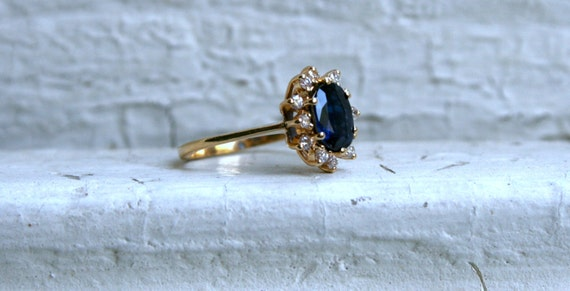 Vintage 14K Yellow Gold Diamond and Sapphire Halo Engagement Ring.