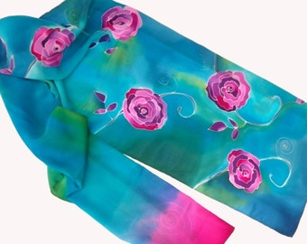 Hand painted silk scarf with theme of purple pink roses in turquoise of cold sea. Turquoise, pink, purple.
