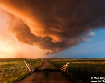Severe Supercell Thunderstorm at Sunset Over a Dirt Road in Montana