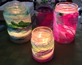 Jar glass lanterns with torn paper