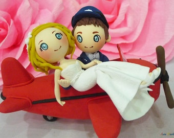 Custom Red Airplane wedding cake topper clay doll,Groom lift Bride clay miniature,ring holder clay figurine,clay couple anniversary decor