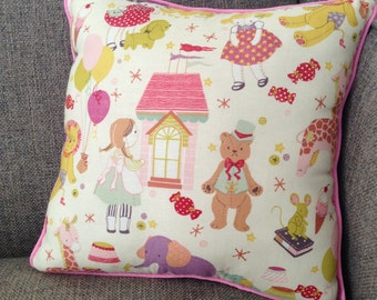 """Dolls, Teddy Bears, Dollhouses and more accent this pillow in Pinks, Yellows and Purples on White Cotton - """"Retro Toyland Pillow"""""""