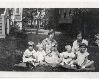 Old Photo Women and Children Girls Boys sitting on Blanket on Lawn 1920s Photograph snapshot Kids vintage