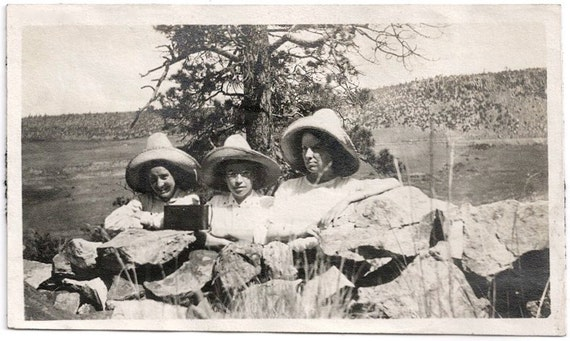 Old Photo Women wearing Hats behind Stone Wall with Camera on Rocks 1910s Photograph snapshot vintage
