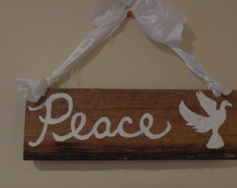 Peace and white dove sign