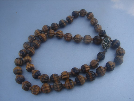 beautiful carved tiger eye bead necklace by doramarvin