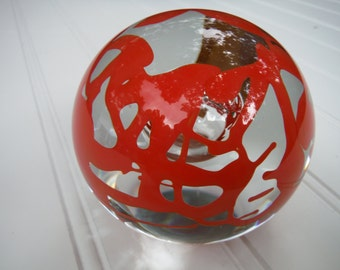 Svoboda Karlov paperweight with orange swirls and central controlled bubble