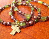 Gemstone and glass mini cross necklace in golds and green