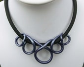 Purple pearl  snake necklace/ Fimo (polymer clay) black spirals tube with transparent paint on a rubber base chain