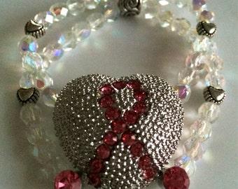 Über BLING Breast Cancer Bracelet