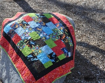 Red, orange, green, blue, black, Lizard Baby Quilt 34 by 40 inches