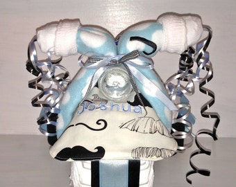 Personalized Mustache Print Diaper Tricycle.  Name is embroidered on the Bib and Burp Cloth for Free.  Mustache & Blue Diaper Trike