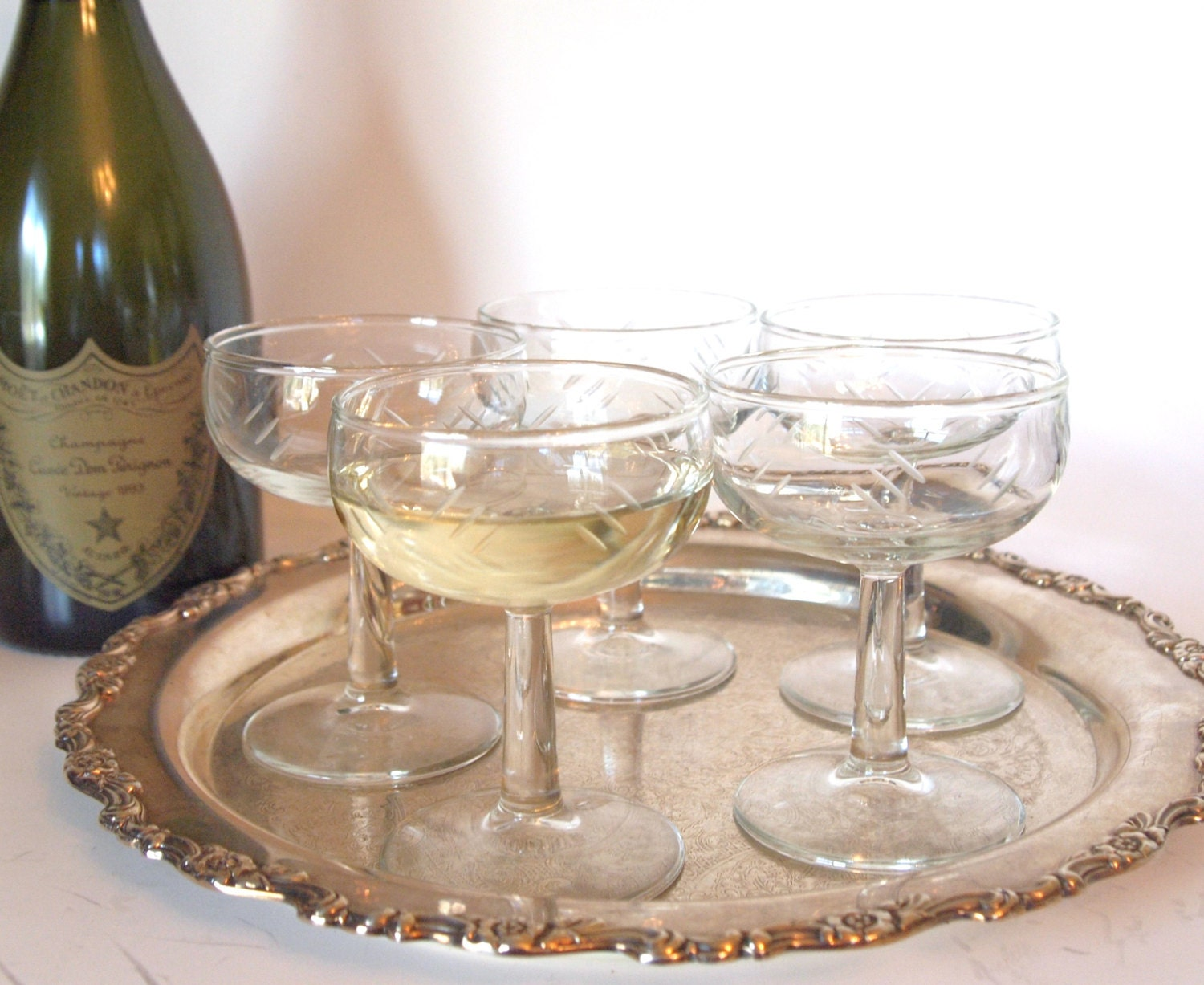 vintage champagne coupe glasses etched with geometric lines. Black Bedroom Furniture Sets. Home Design Ideas