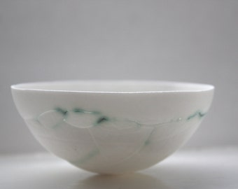 White porcelain bowl. Decorative stoneware English fine bone china bowl with a unique texture with green hues.