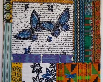 Fiber Art Wall Hanging, An  original piece of art made from fabric and quilted together. International fabrics with butterflies fly together