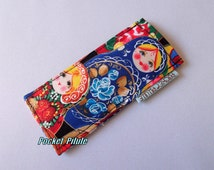 "Case with pill "" Collection dolls Matriochkas "" blue, yellow, red"