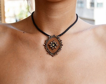 Vintage leather and metal pendant with colored stones