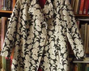 lovely COAT of EMBROIDERED CLOTH in black with white flowers with red lining
