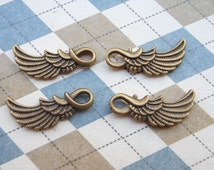 50 pcs of Antique Bronze wing Charms 10mmx25mm