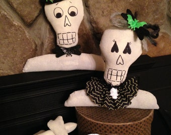 Halloween Primitive Mr. and Mrs. Bones Skeleton Figure Heads with Spare Bones.