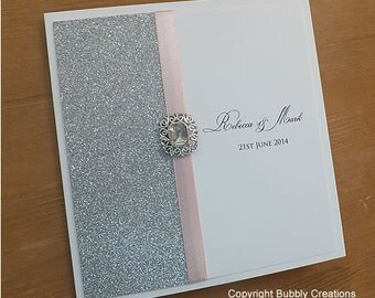 Glitter Wedding Invitation. Silver wedding invite with light pink ribbon and embellishment. Sparkly and Glitzy wedding stationery - SAMPLE