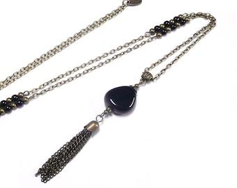 Long pendant necklace, bronze jewelry, long pompom pendant, black beaded necklace,vintage jewel