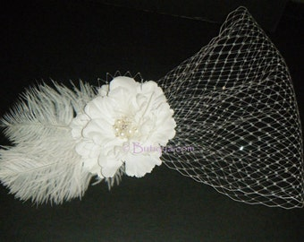 Silk Flower Fascinator with feather, crystal and pearl accents.