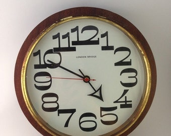 Wall Clock in wood and brass vintage 70s