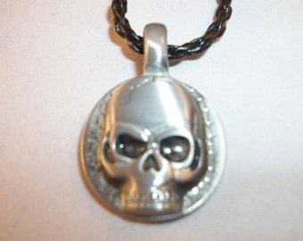 Pewter skull pendant on black, braided cord