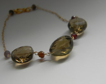 SALE. bracelet. smokey quartz. rhodolite garnet.
