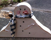Primitive Country  1672SNB Melting Snowman homespun scarf, rusty bell, and 'I'd melt for you' tag.