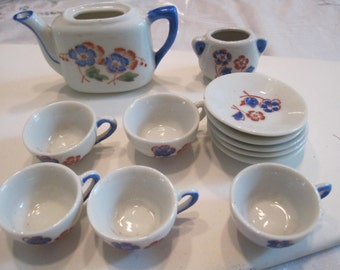 vintage doll house tea set with  cups,.saucers.,tea pot,.and sugar....12 pieces in all