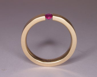 Hand Made in Canada and Hammer Forged 14k yellow gold Tension engagement ring holding a 3mm Ruby.