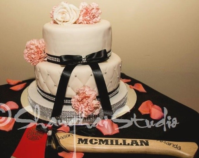 Customized Firefighter axe wedding cake cutter.