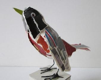 Redstart, little bird made of packaging material