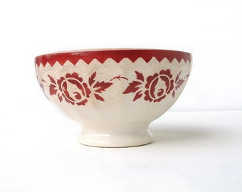 Antique french extra large cafe au lait bowl with red stencil flower design.
