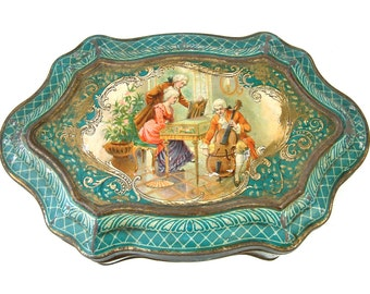 Antique french lithographed biscuit tin with music lesson scene. Teal and gold detail. Vintage shabby tin. Storage tin. Sewing. Button box