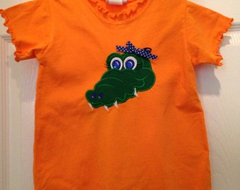 Orange  bubble with Gator face on the front and tail on the back!.  Great for that little florida gator fan