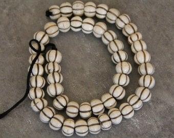 "Buffalo  Bone  Carved Pumpkin Beads, 18"" long full strand"
