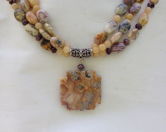 Crazy lace agate three-strand necklace with pendant