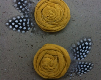 mustard rosette with spotted new guinea feathers on clip