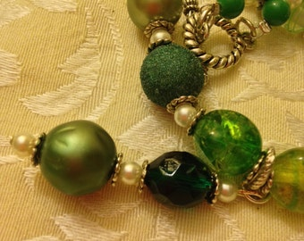 Handcrafted green necklace strung with vintage beads. Comes with matching earrings.