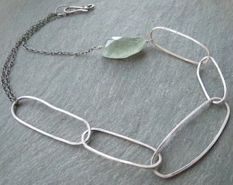 Statement necklace. Faceted aquamarine gemstone with handmade, handformed sterling silver links