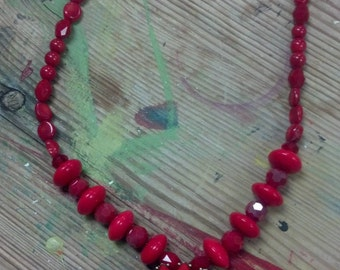 Red glass beads and red coral with a red pendant