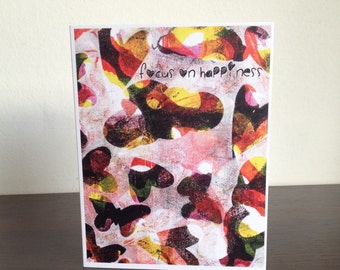 "Card. Quote. ""Focus on Happiness."" Butterflies and Hearts design. Red. Yellow. White."