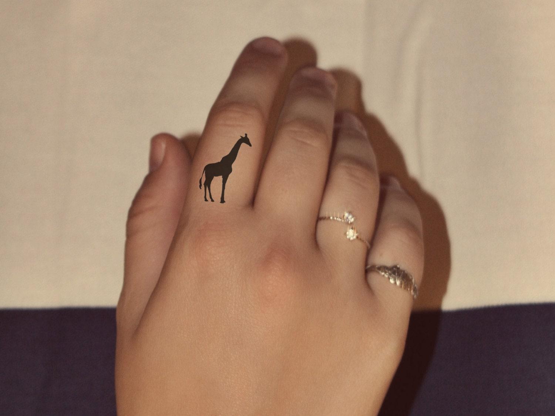 Cute giraffe temporary finger tattoo design set by for Temporary finger tattoos