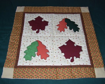 This is a small quilt with plenty of leaves on it. It is machine quilted and appliqued. Good for a wall,table or door.Fall is here!