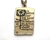 Hippie Peace Medallion Rare French 1960s Bilingual War Is Not Healthy Vintage Anti War Icon La Guerre N'est Pas Bonne flower Logo