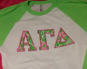 alpha gamma delta neon lilly baseball shirt in size extra small to extra large message other greek letters